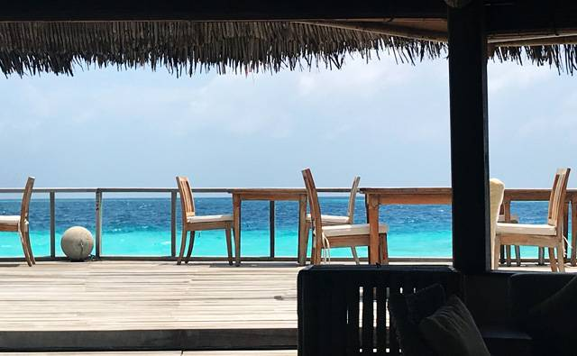 Decking in the bar area on a cloudy but hot day on Makunudu in the Maldives