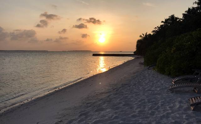 A yellow sunset in Makunudu in the Maldives.